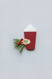 Hot christmas / Creative concept photo of christmas coffee take away cup made of paper on grey background.
