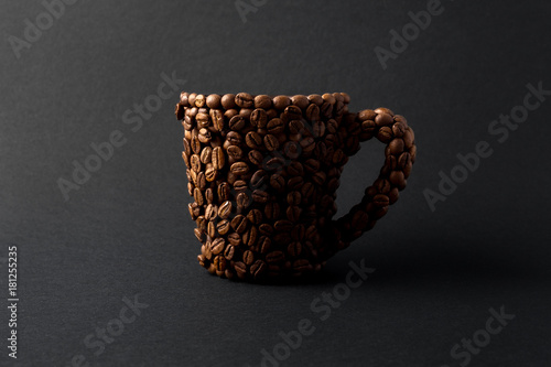 Coffee cup / Creative concept photo of a cup made of coffee on black background.