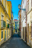 View of a narrow street in the historical center of Lisbon, Portugal.