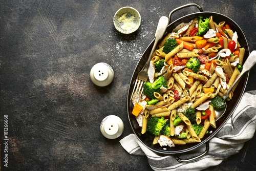 Whole grain penne pasta with vegetable and roasted chicken.Top view. - 181266668