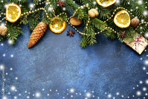 Dark blue christmas background with fir branches and spices.Top view with copy space. - 181266863