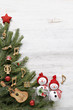 Snowman with christmas tree , music notes, instruments on wooden background