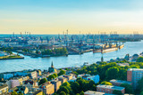 Beautiful view of famous Hamburger Landungsbruecken and industrial port on Elbe river in Hamburg, Germany - 181276419