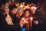 Friends With Sparklers At The New Year Party - 181276680