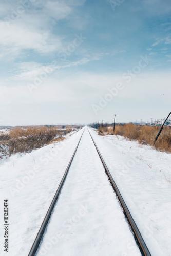 Fotobehang Spoorlijn Railroad tracks covered in snow.
