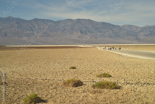 Foto op Canvas Grijs distant people tiny in vast desert landscape Salt Flats Death Valley