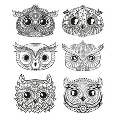 Owls. Heads. Design Zentangle. Hand drawn owl with abstract patterns on isolation background. Design for spiritual relaxation for adults. Black and white illustration for coloring. Zen art