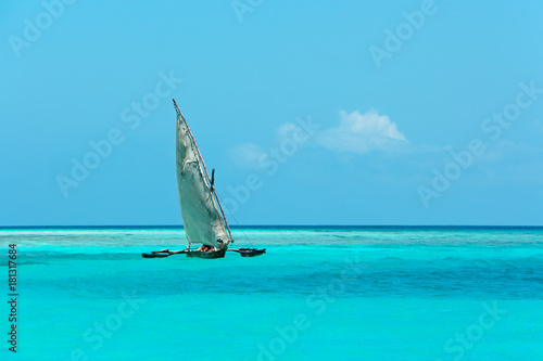 Deurstickers Zanzibar Wooden sailboat on water