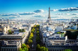 panoramic view of famous Eiffel Tower and Paris roofs, Paris France, retro toned