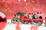 toy train on red bokeh background