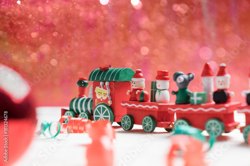 Wall mural toy train on red bokeh background