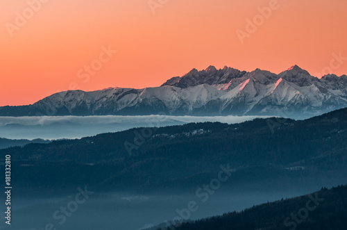 Poster Oranje eclat panorama over misty Gorce to snowy Tatra mountains in the morning, Poland landscape