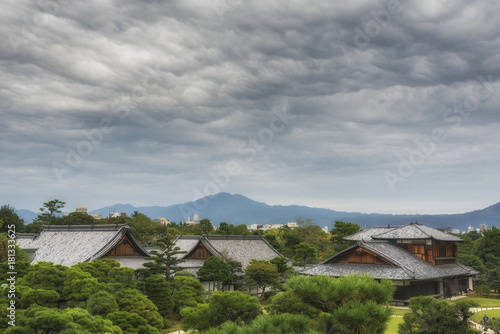 Staande foto Kyoto Panoramic view of Kyoto from Nijo Castle and Honmaru palace with dramatic sky. Japan.