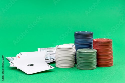 Poker chips with playing cards and money on the green background. Poster