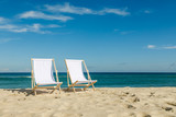 Deck chairs on beach - 181339282