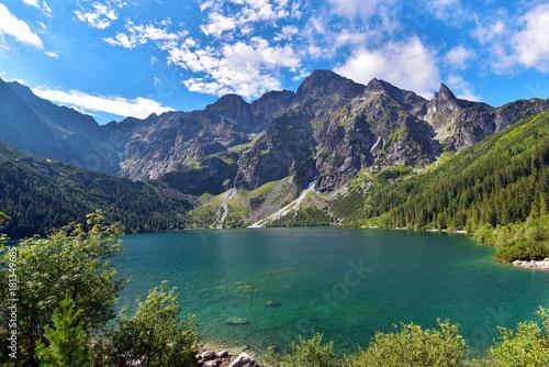 Green water of Morskie Oko lake in summer, Tatra Mountains, Poland