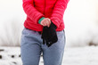 Woman putting on winter gloves