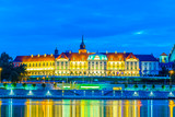 The royal castle and the old town of warsaw reflected on the Vistula river during night, Poland. - 181352226