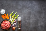 Composition of raw meat with vegetables and spice on wooden background - 181356044