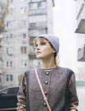 Modern young woman in hat on city street, cold  weather, cityscape, outdoor, autumn season, selective focus - 181356888