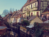 Traditional  old  houses on the canal decorated for Christmas, Colmar, Alsace, France. Toned image. - 181364655