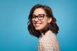 Smiling woman posing in glasses