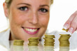 woman with coin stack while saving money
