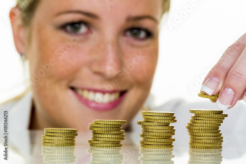 Fototapeta woman with coin stack while saving money