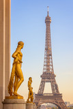 Golden bronze statues on Trocadero square, Eiffel tower in the background, Paris France - 181368086