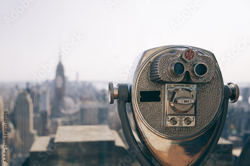Binocular against observation deck view. Poster