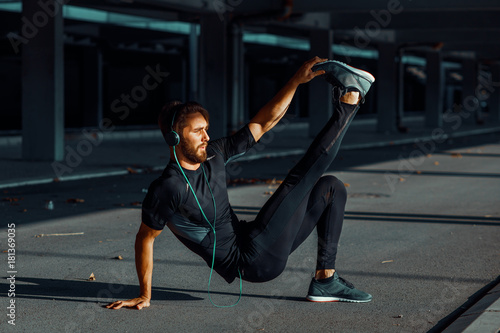 Wall mural Young man exercise outdoors