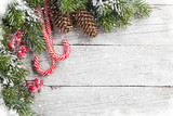 Christmas snow fir tree and candy canes - 181375242