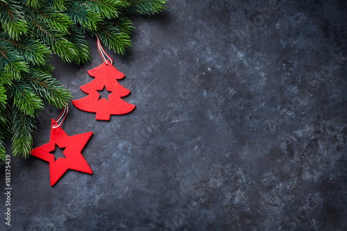 Christmas fir tree and decor over stone background - 181375439