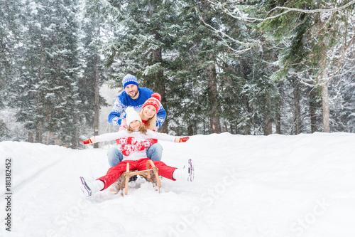 Happy family outdoor in winter