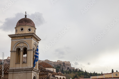 Fotobehang Athene Pantanassa Church on Monastiraki Square, in the city center of Athens, Greece, with the iconic Acropolis in the background.