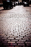Old cobblestone street with cars, New York City - 181383493