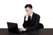 Pensive Caucasian businessman with laptop
