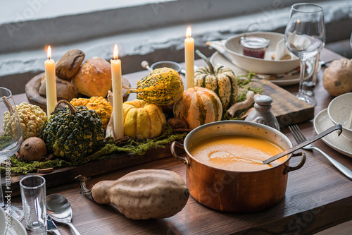 Autumn table setting with pumpkins. Thanksgiving dinner and fall decoration.