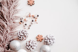 Woman Christmas background on white. Frosty pine cones, silver colored decoration balls, faux fur, jewelry. Copyspace for text, overhead, horizontal - 181393635