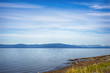 Qualicum beach in Vancouver Island, with the Canadian Rockies in the background, BC, Canada