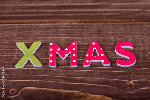 Poster Word Xmas from wooden letters.
