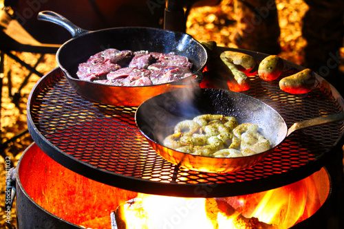 Aluminium Canada A surf and turf meal being cooked on a campfire