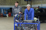 auto mechanic shows trainee maintenance of car engine - 181412800