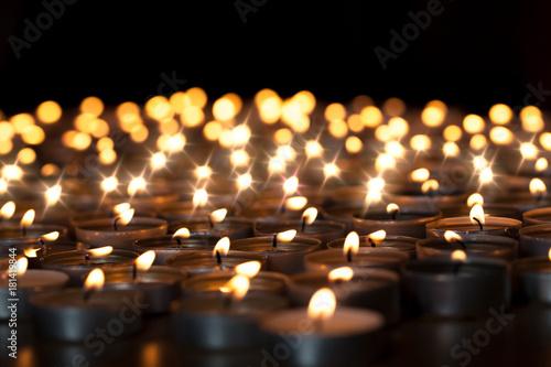 Tealight candles. Beautiful Christmas celebration, religious or remembrance candlelight image. Romantic candlelit vigil © Ian Dyball