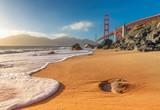 Golden Gate Bridge at Sunset Seen from Marshall Beach, San Francisco, California.