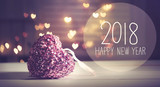 New Year 2018 message with a pink heart with heart shaped lights - 181436618