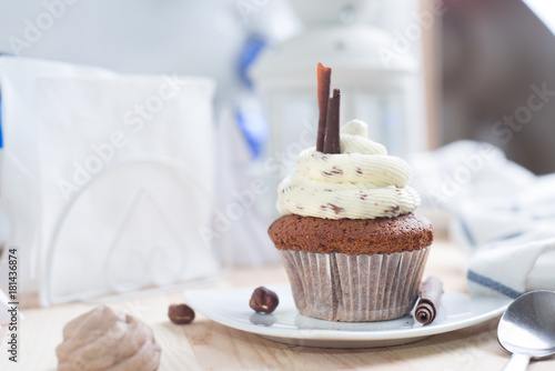 Chocolate cupcake with white cream Poster