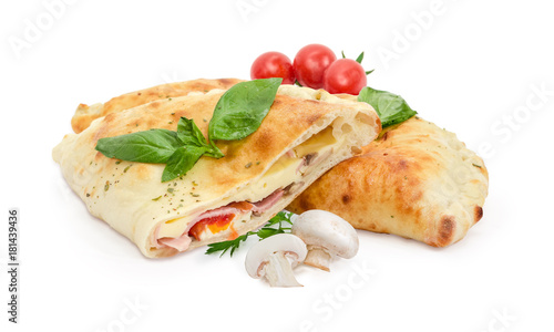 Whole and half of baked calzone, mushrooms, cherry tomatoes