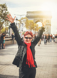Happy attractive mature woman retired on the Champs Elysees in Paris. Travel, outdoor activities, shopping in Paris