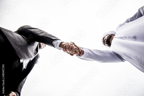 Arabic businessman giving an handshake to his business partner Poster